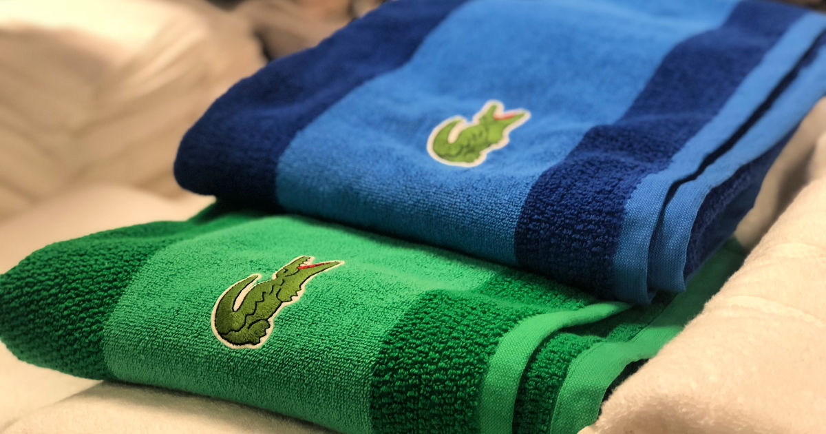 blue and green lacoste colorblocked towels in store