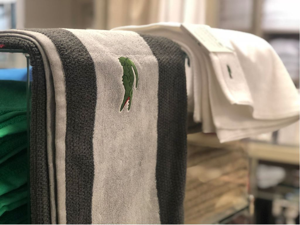 grey lacoste towel in store