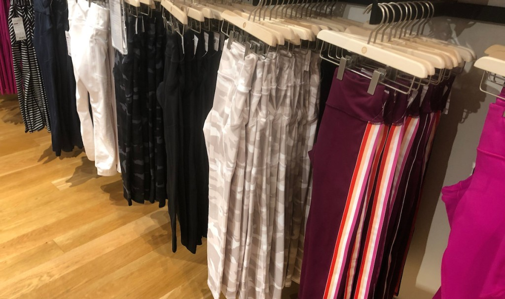 various colors of leggings lined up at store