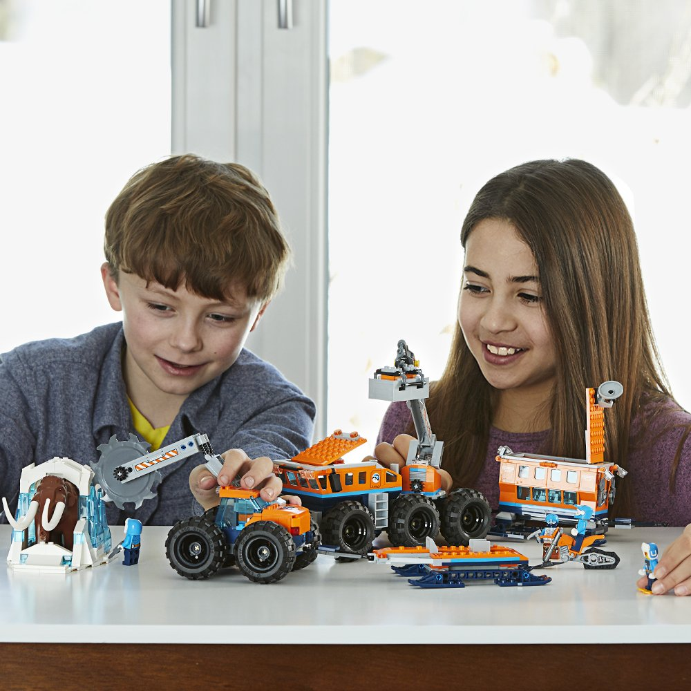 Boy and Girl playing with LEGO Arctic Base