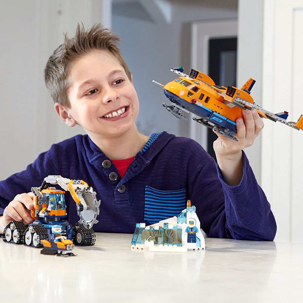 Boy playing with Lego Plane