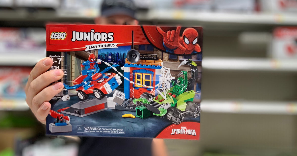 stetson holding lego juniors spiderman in walmart