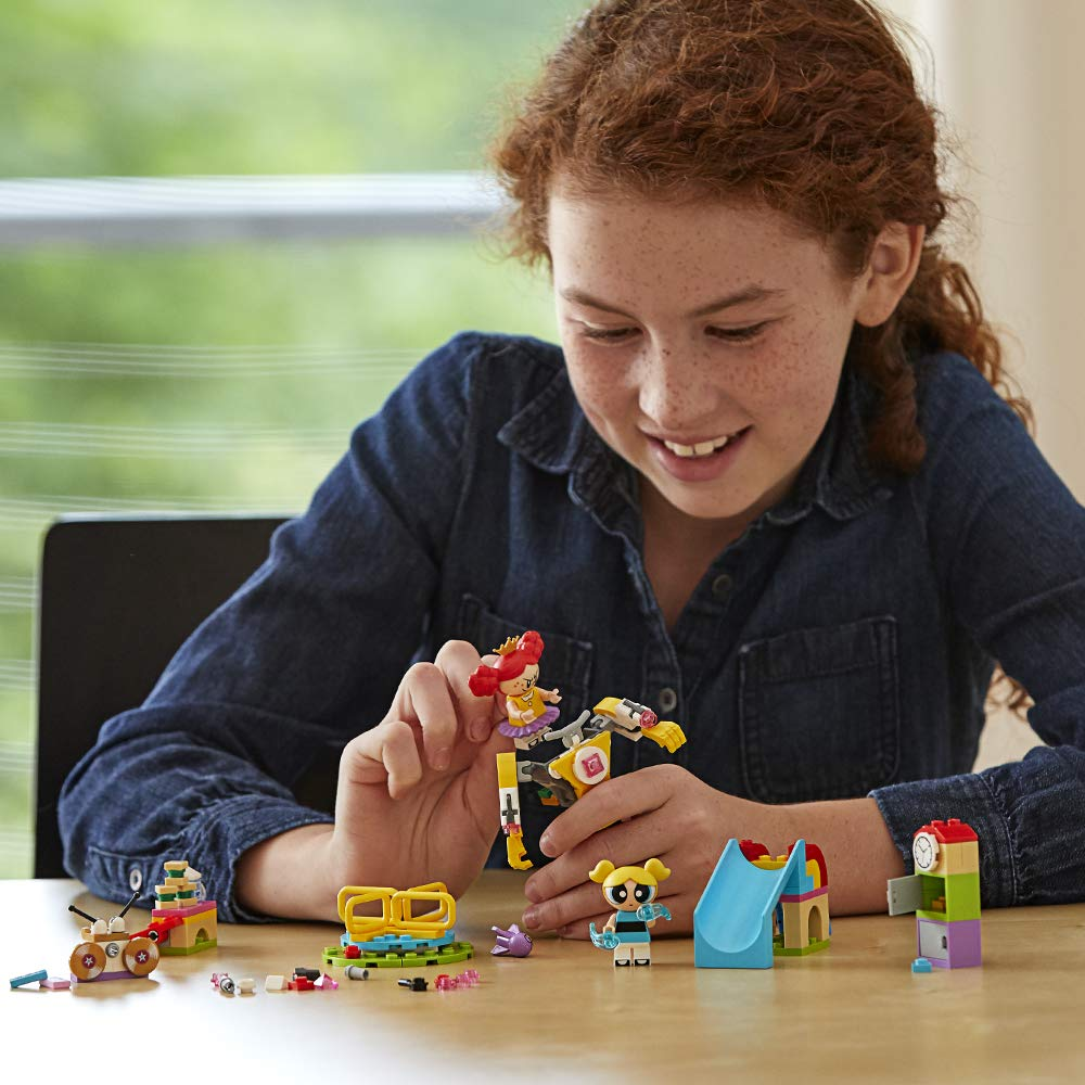 Girl Playing with Powerpuff LEGO set