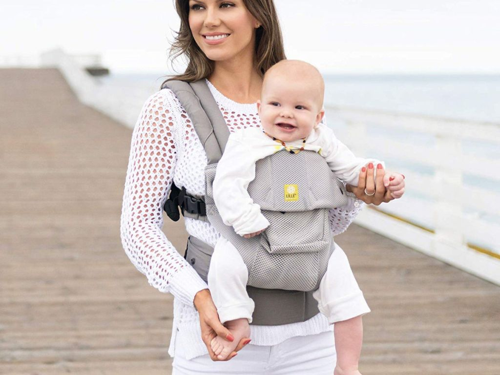 woman wearing lillebaby airflow carrier at the beach boardwalk