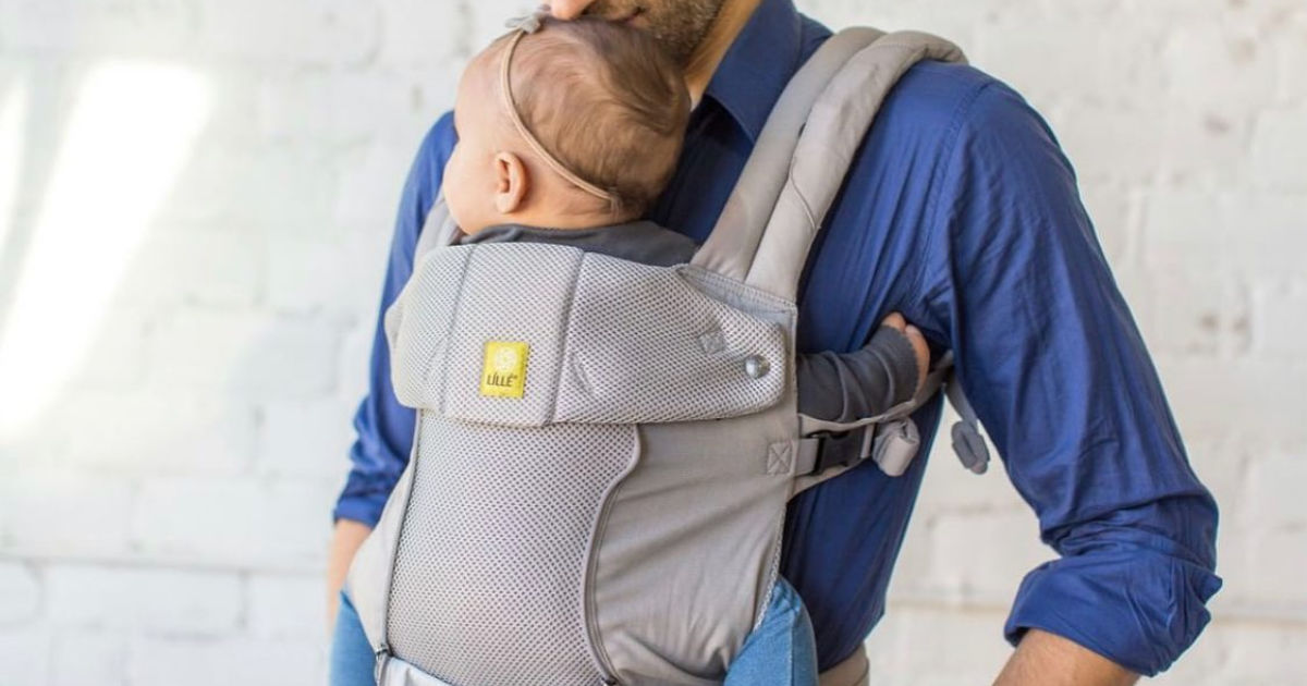 man wearing lillebaby carrier with baby in it