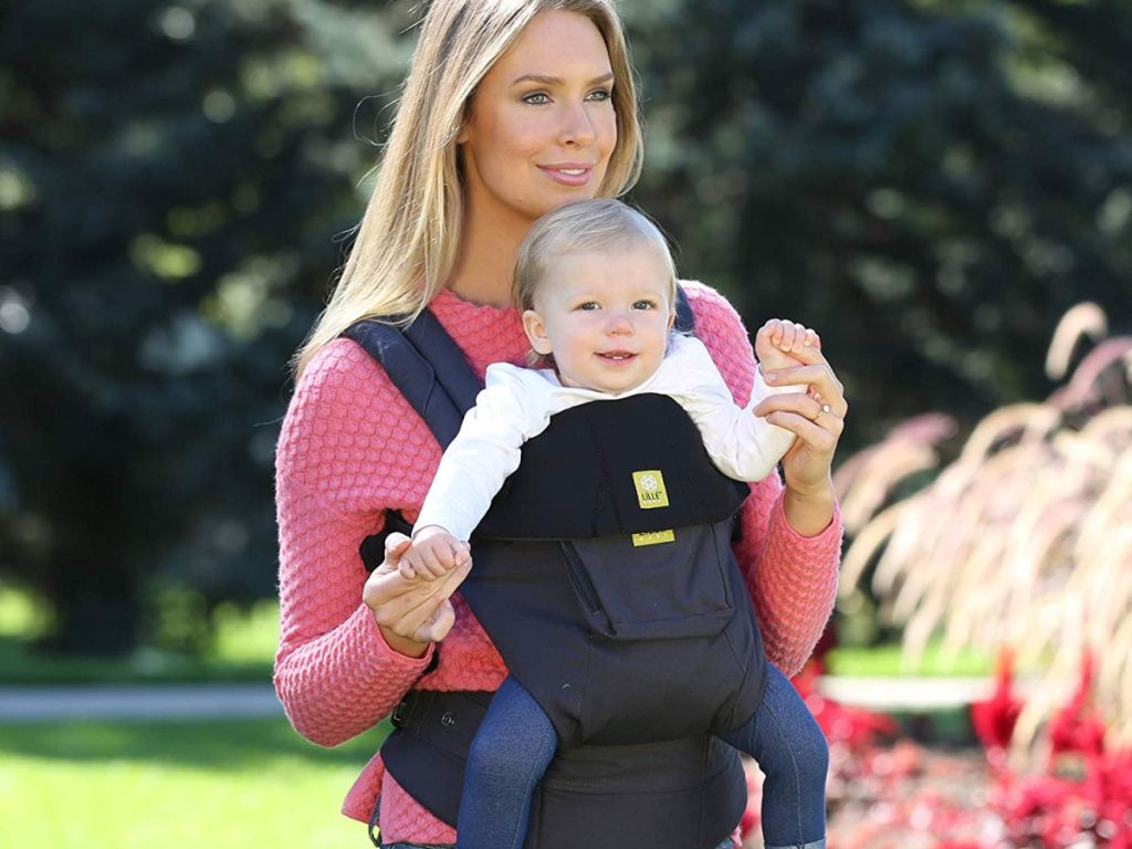 woman wearing baby with lillebaby the complete original in black outside