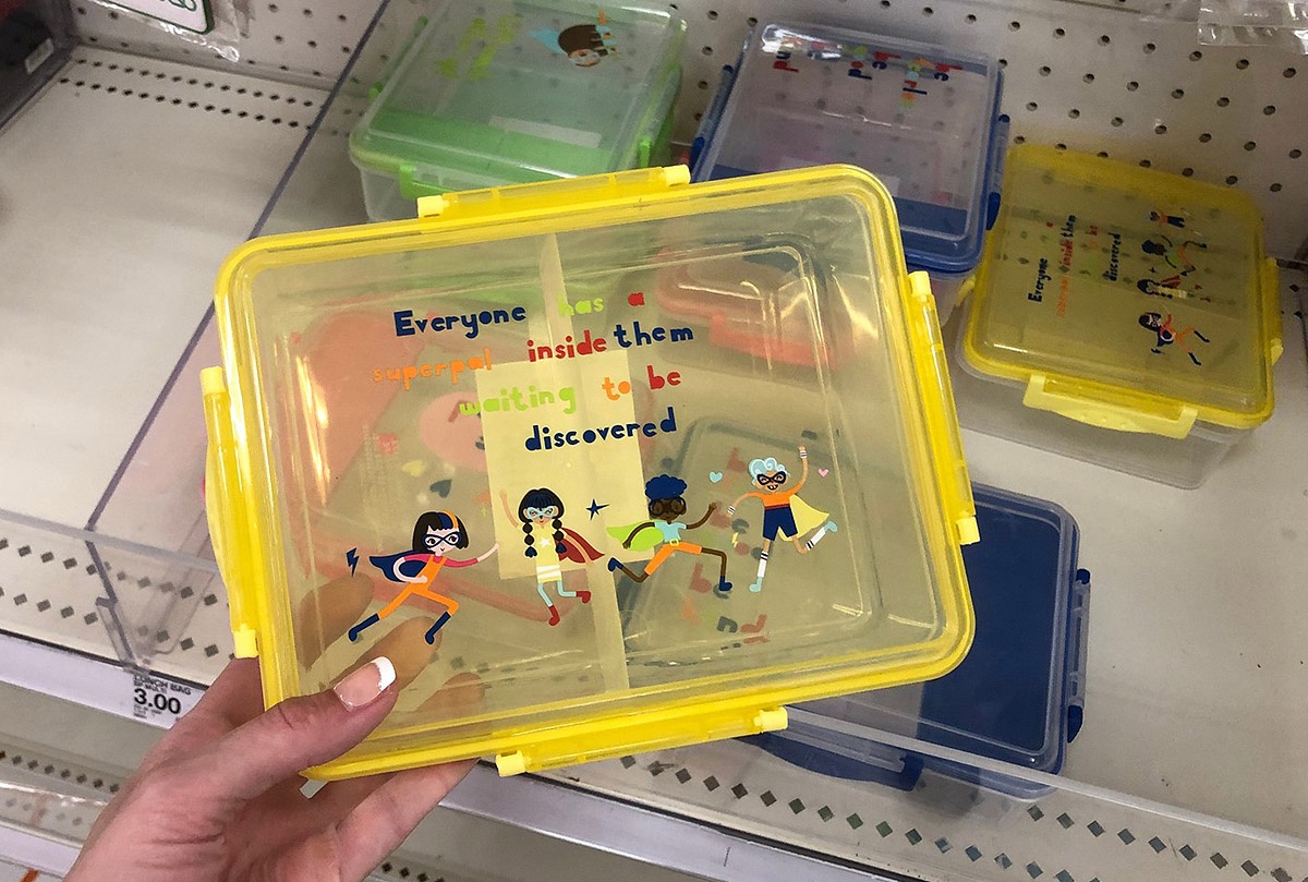 clear lunch boxes in yellow, blue, and green in store
