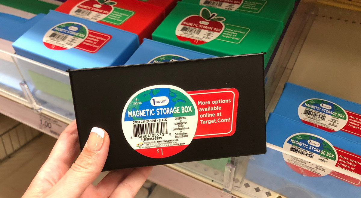 magnetic storage box being held in hand at store