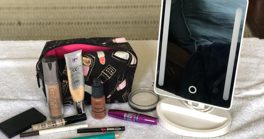 make up bag with various products and mirror