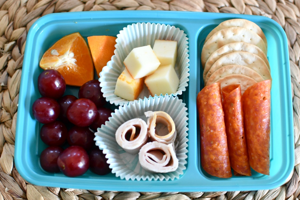DIY lunchable with crackers in a lunch container