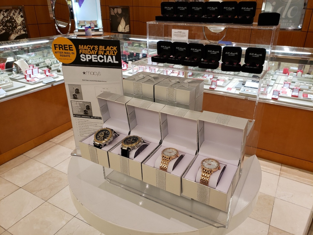 men and womens gold watches at macys on display