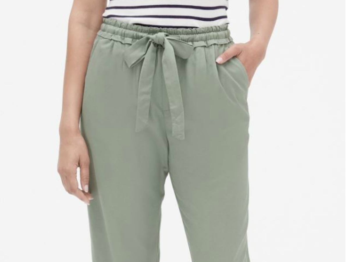 woman wearing pants with hand in pocket