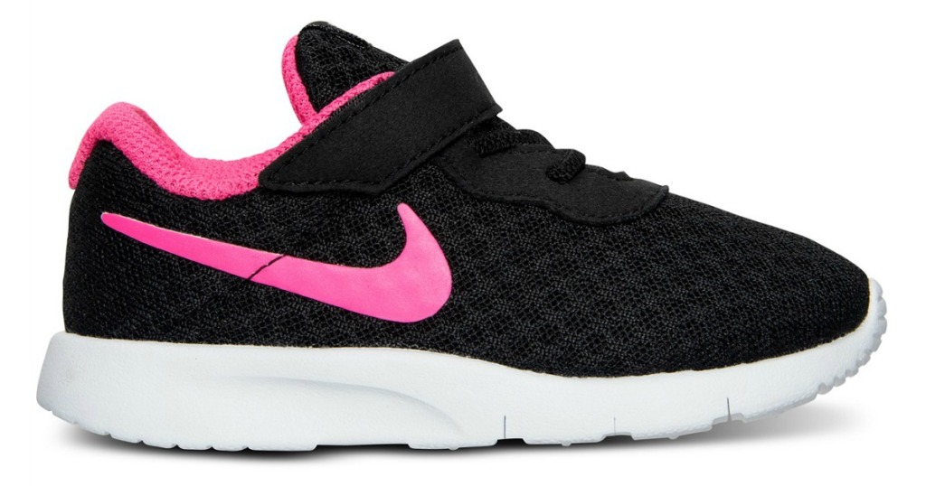 black Nike shoe with pink swoosh