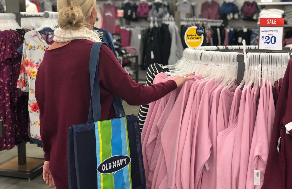 woman shopping in store with old navy tote on shoulder