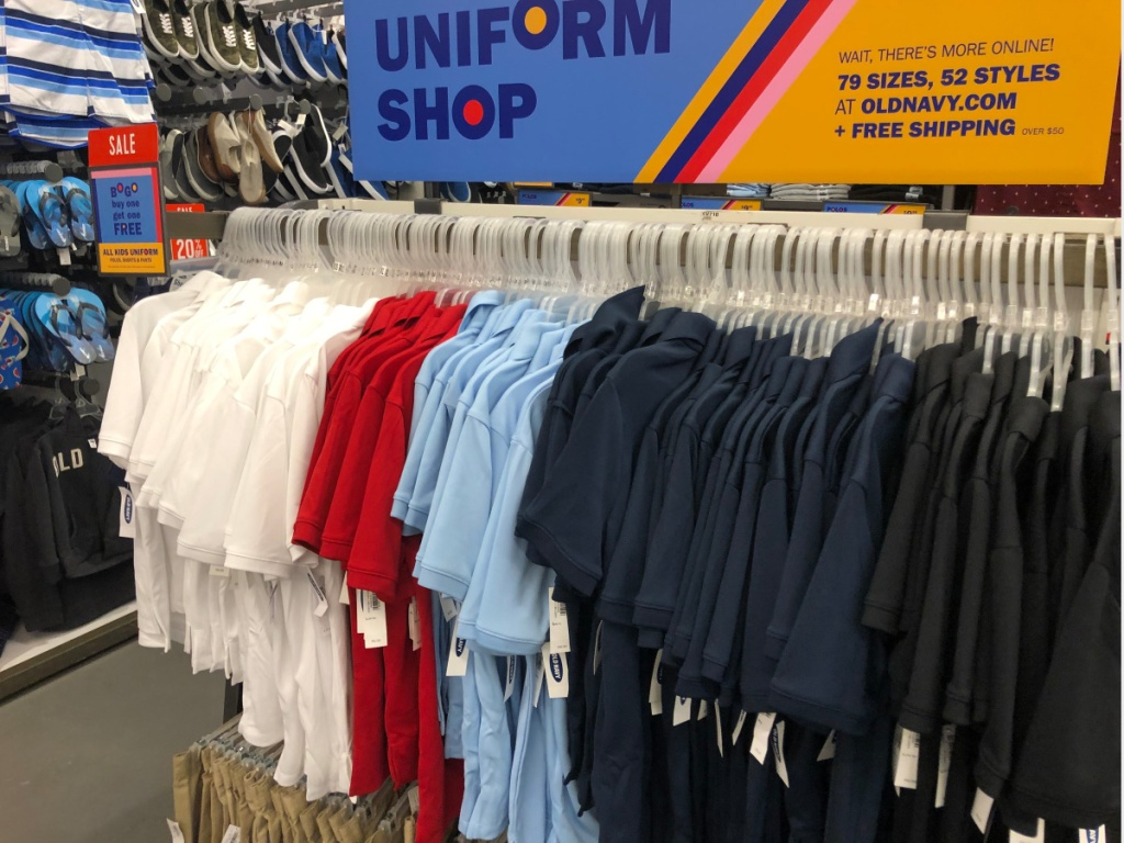 old navy polo uniform shirts on rack in store