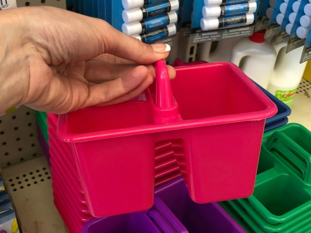hand holding pink pencil caddy in store