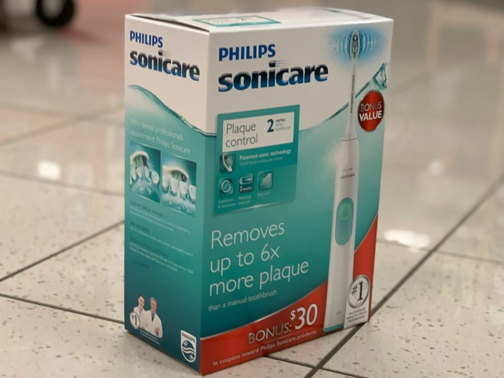 box with toothbrush on store floor