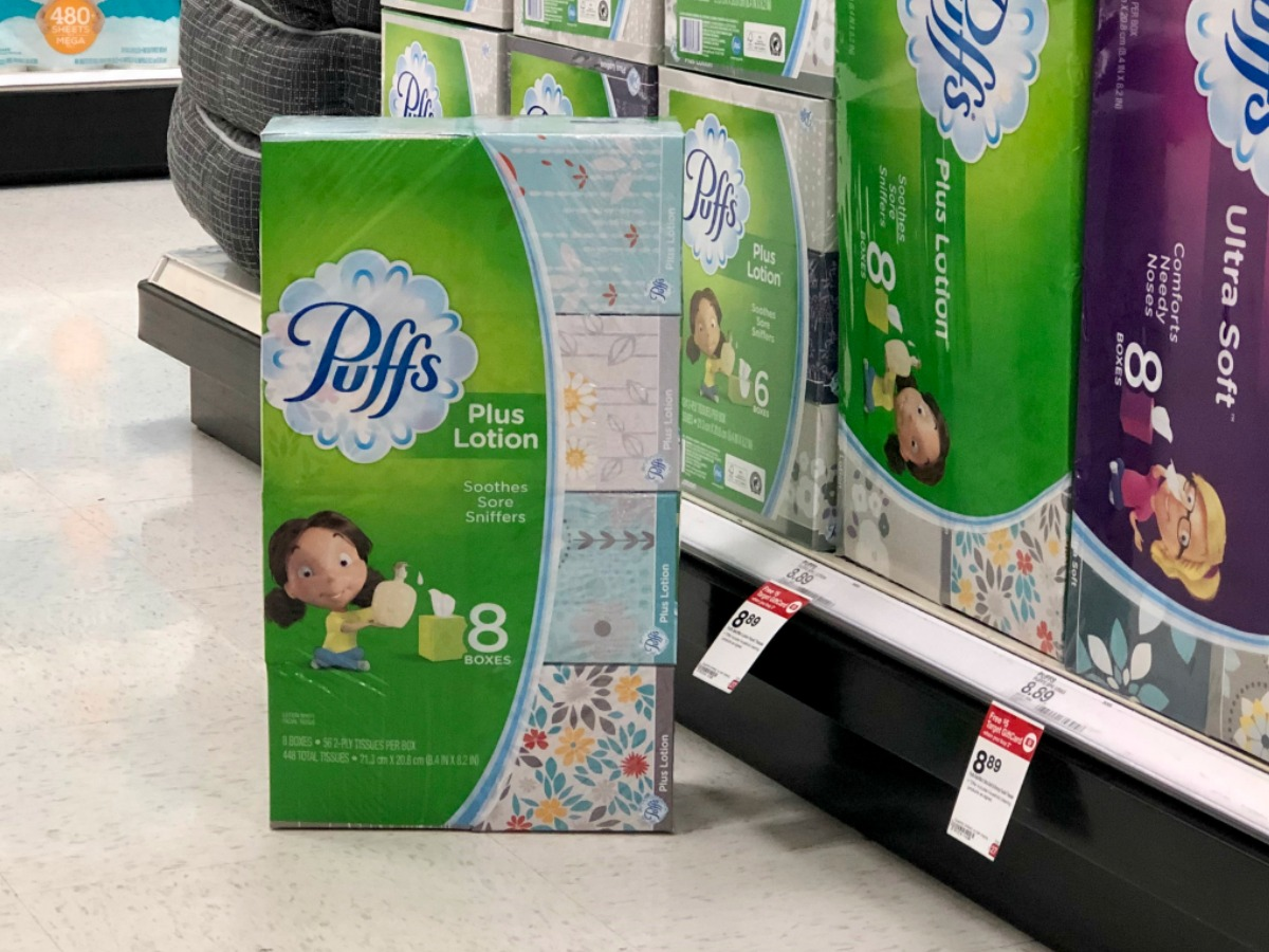 packs of puffs tissue by store display