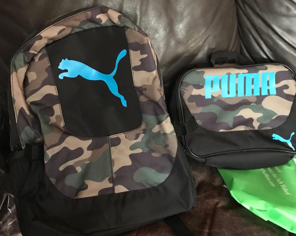 camo puma bookbag and lunchbox sitting next to each other