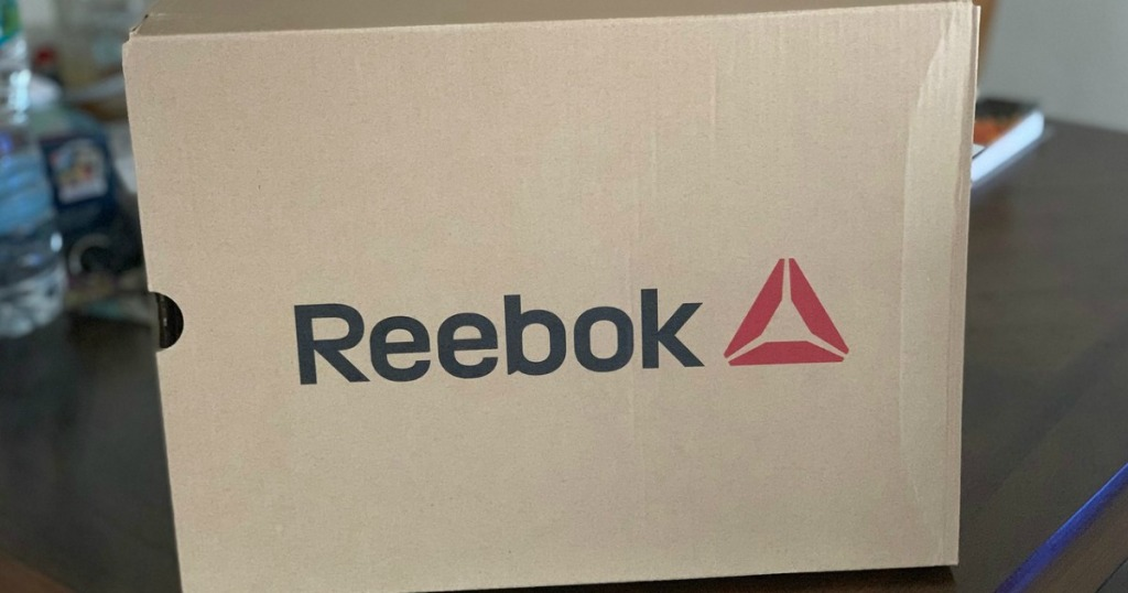 box on table with Reebok logo on it