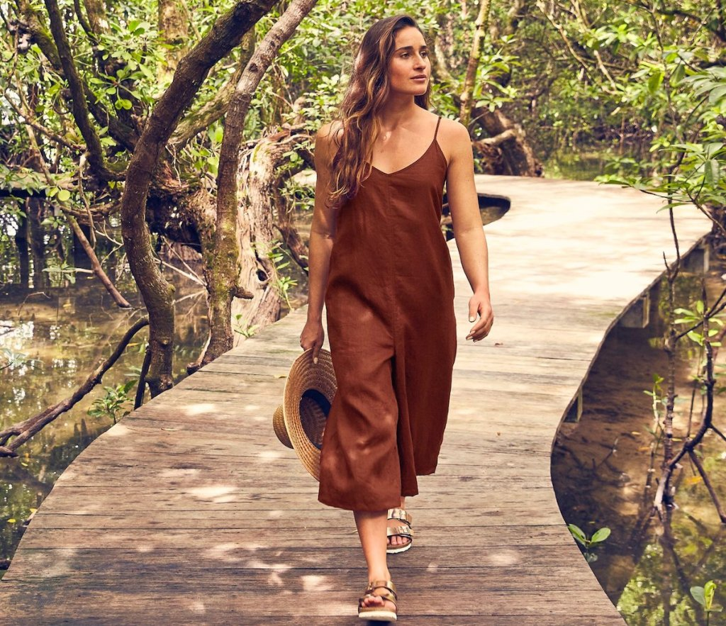 woman wearing rust colored romper