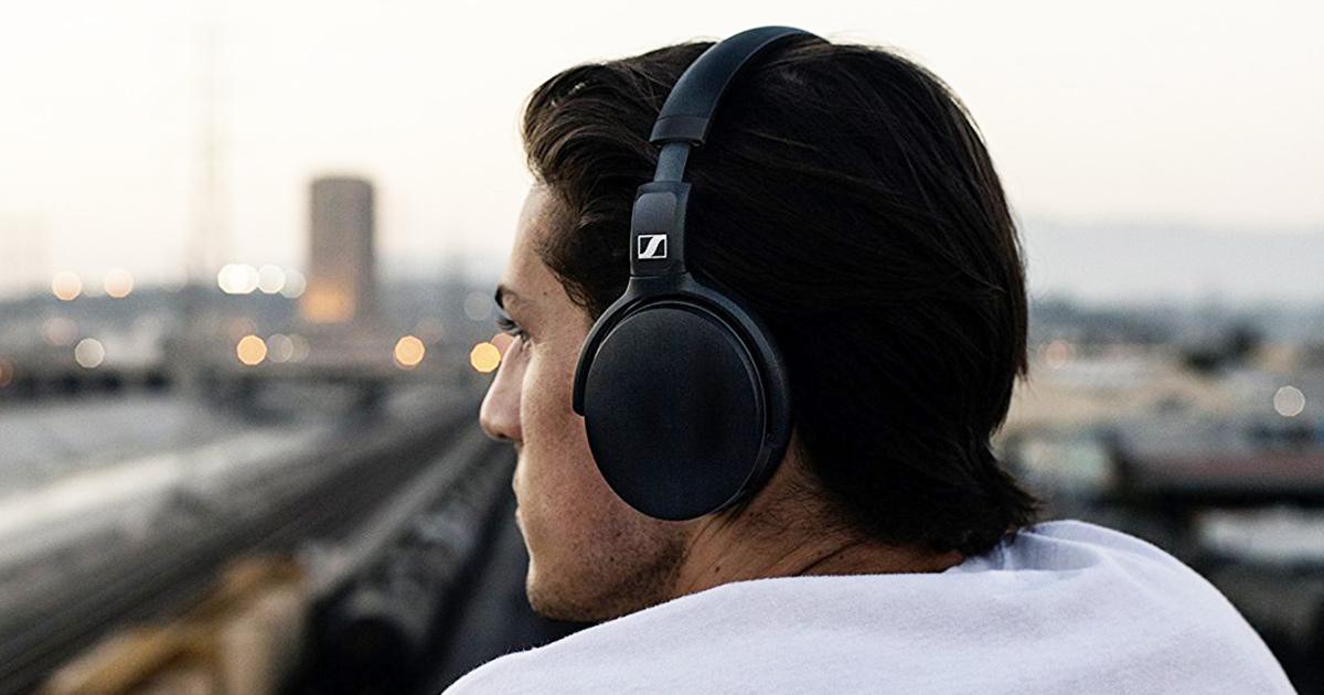 man wearing sennheiser headphones
