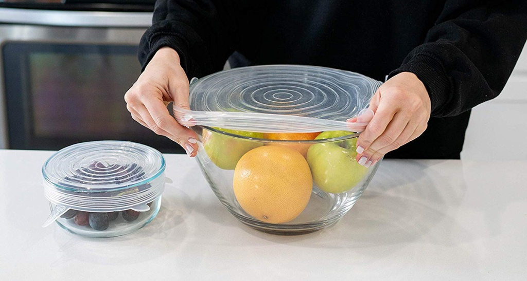 silicone lids being stretched over bowl to avoid waste of money