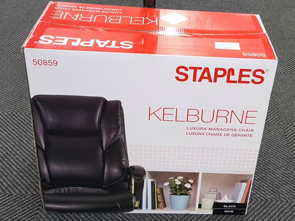 box with office chair in it on store floor