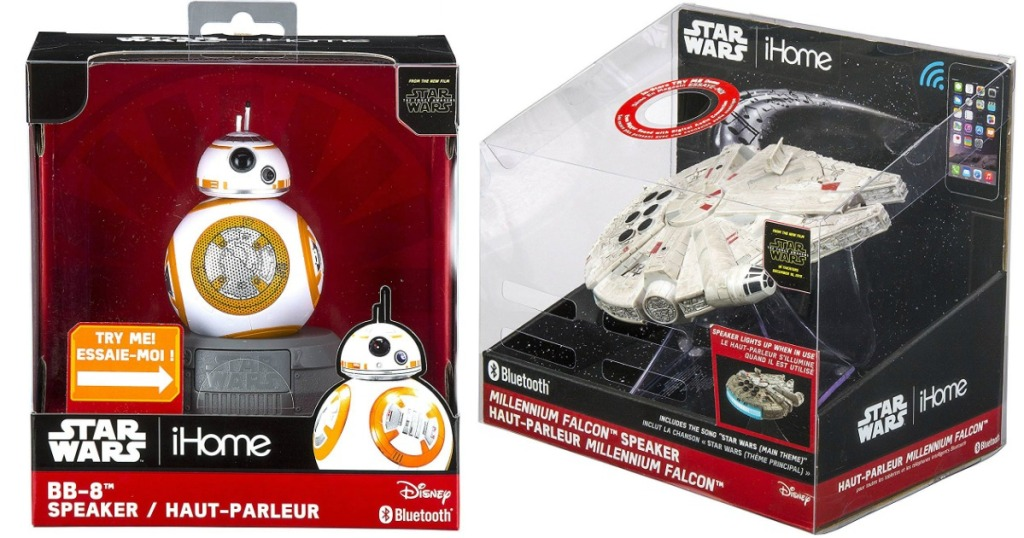 two star wars toys in boxes on white background