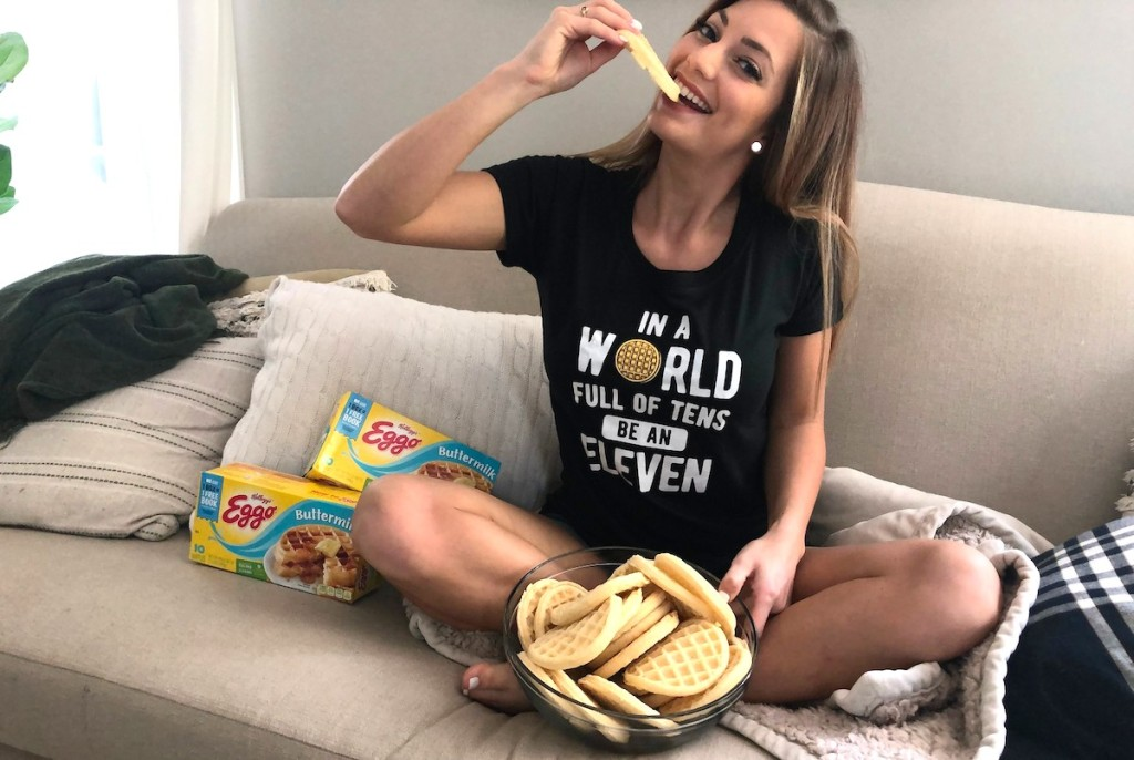 woman eating waffle wearing stranger things shirt