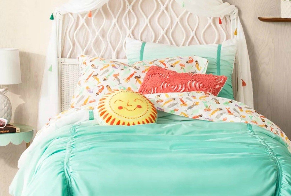 Happy face round sun throw pillow on bed