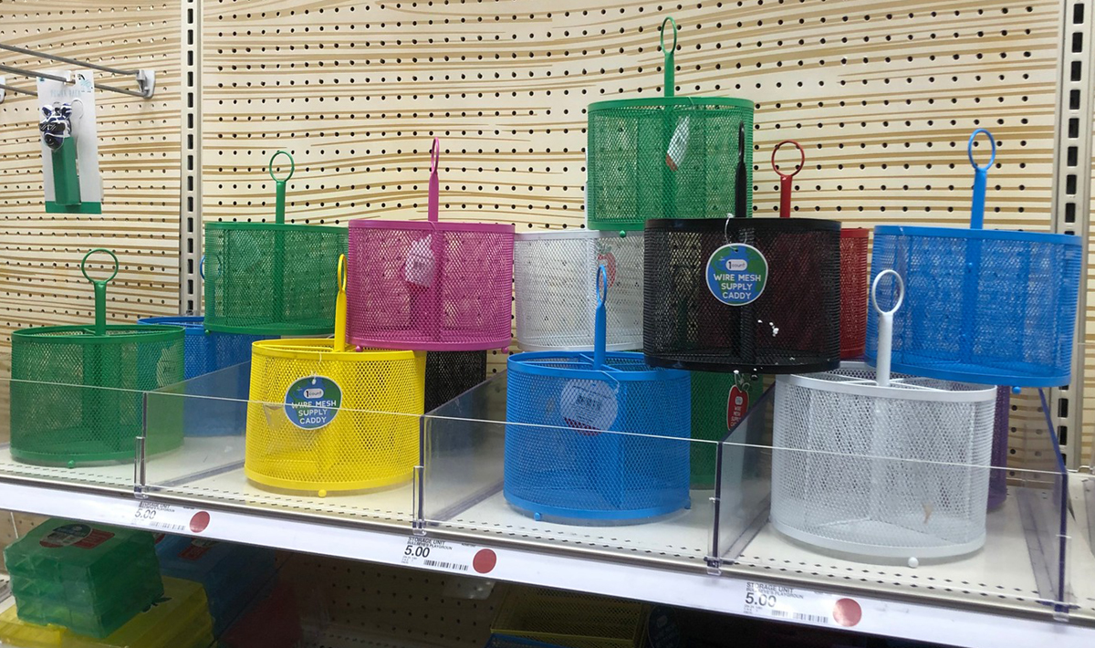 wire mesh supply caddies in various colors on a store shelf
