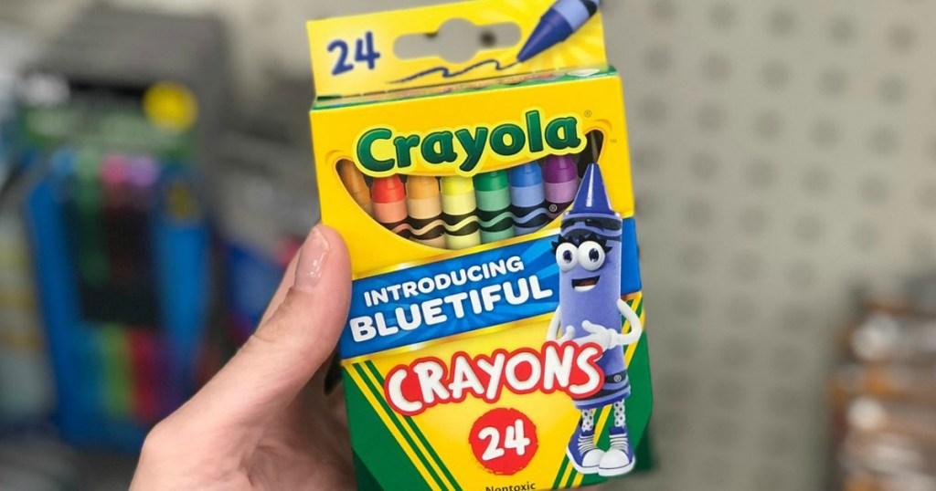 hand holding crayola crayons at target
