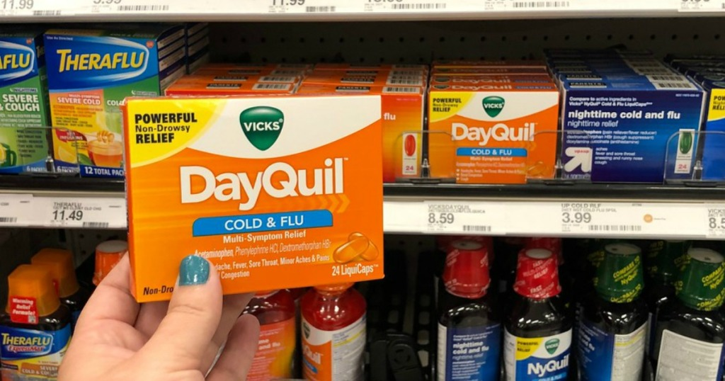 hand holding dayquil liquicaps at target