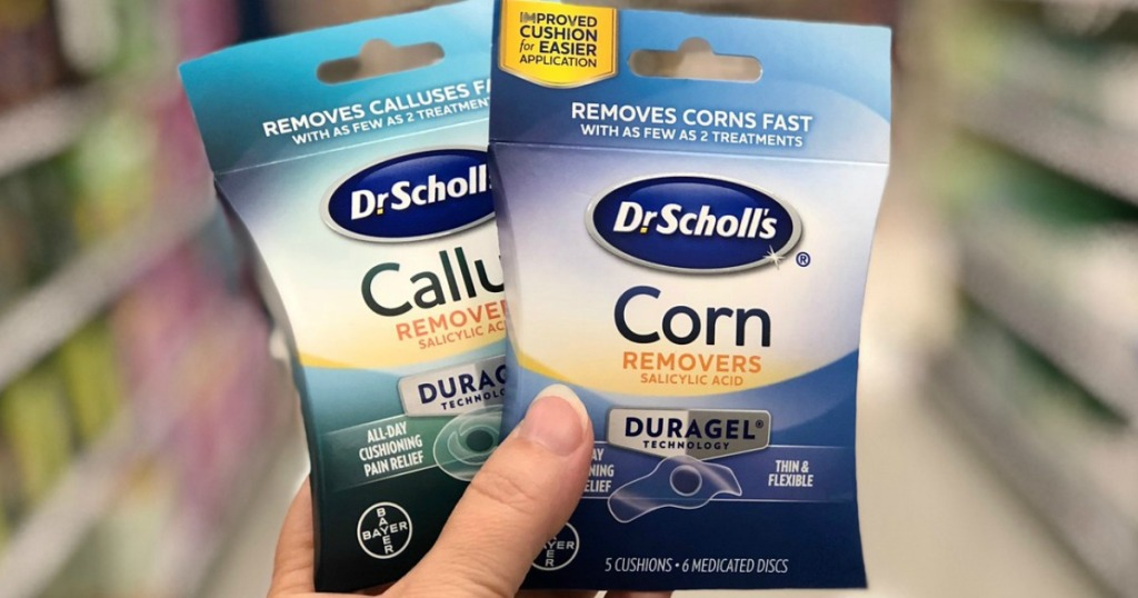 hand holding dr. scholl's duragel callus and corn removers at target