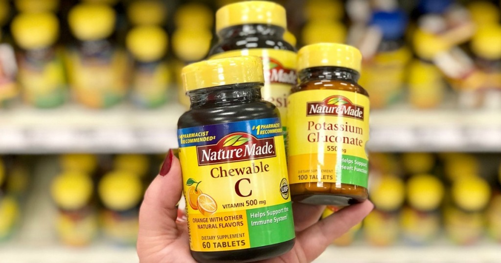 hand holding nature made vitamins at target