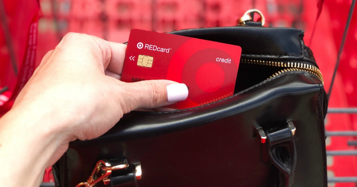 hand holding target REDcard from black purse with red cart