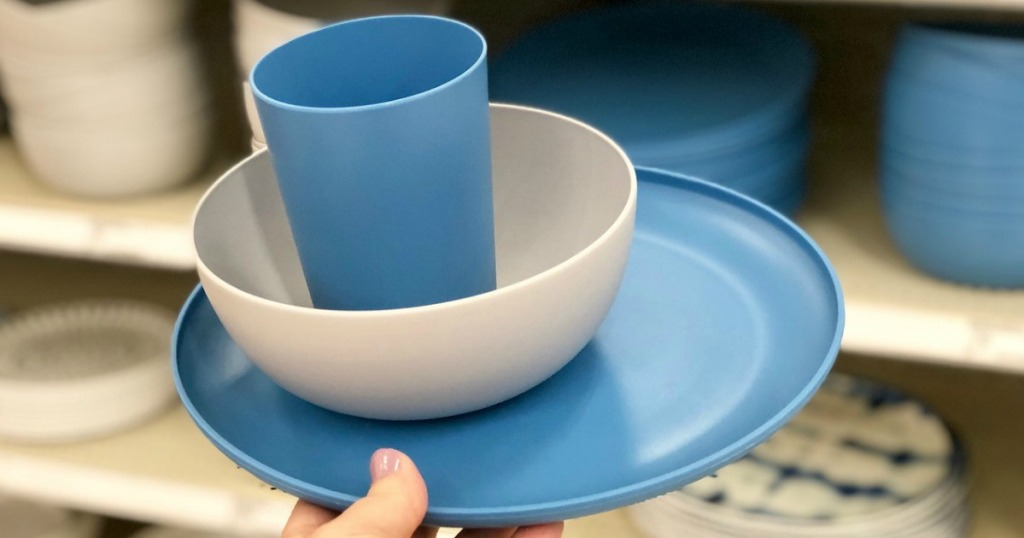 hand holding room essentials dinnerware at target