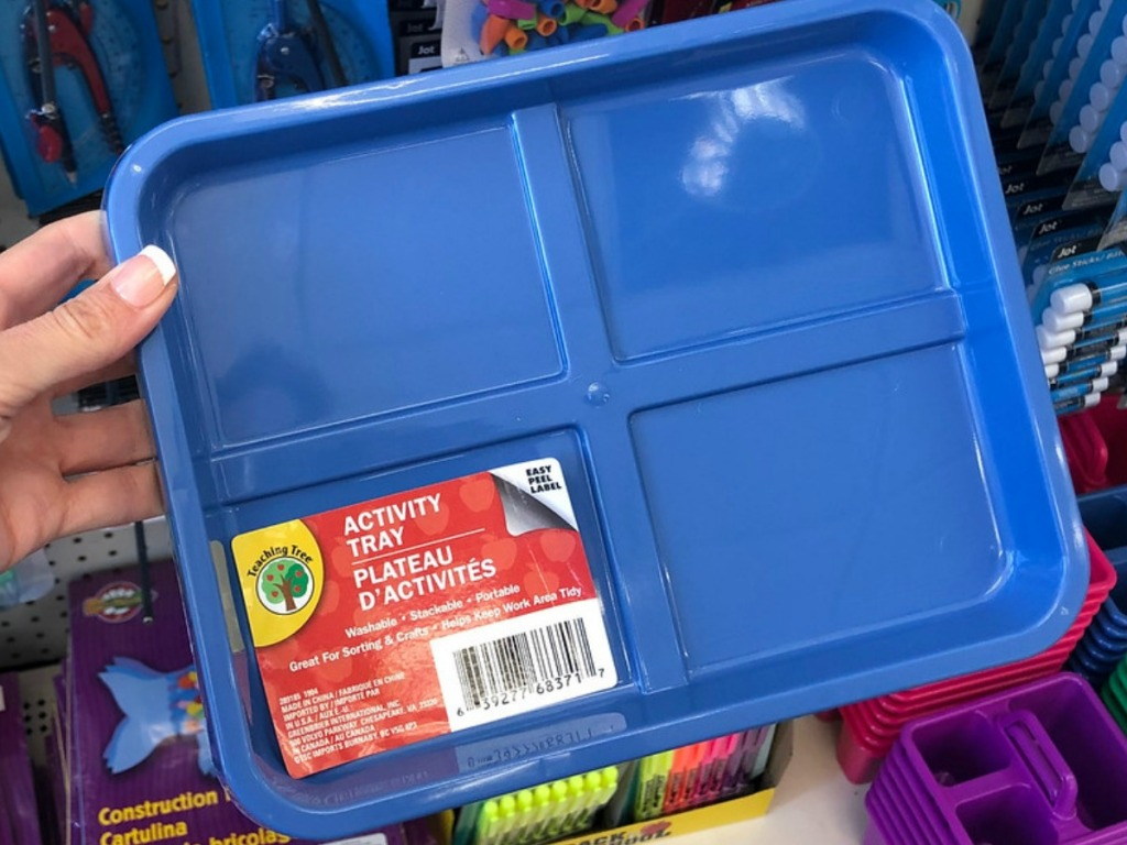 handing holding blue plastic tray in store