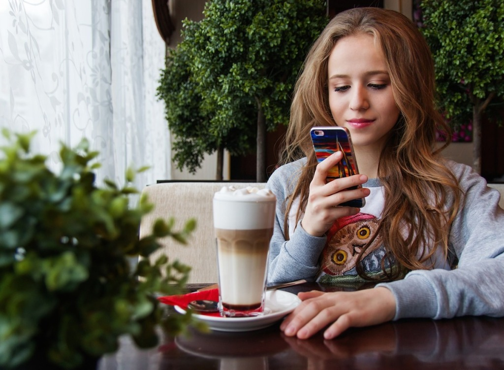 teenager girl looking at cell phone