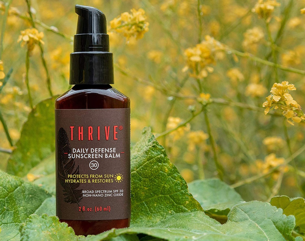 thrive sunscreen outdoors with greenery