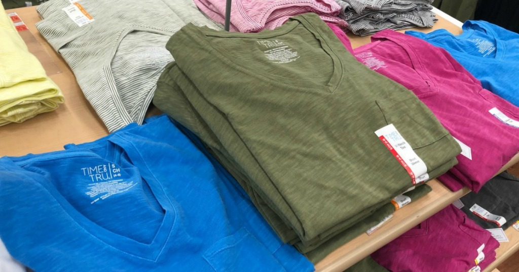 t shirts on table in store
