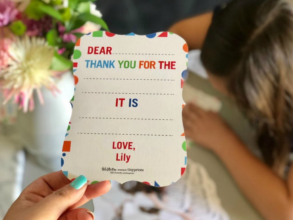 hand holding tiny prints thank you card