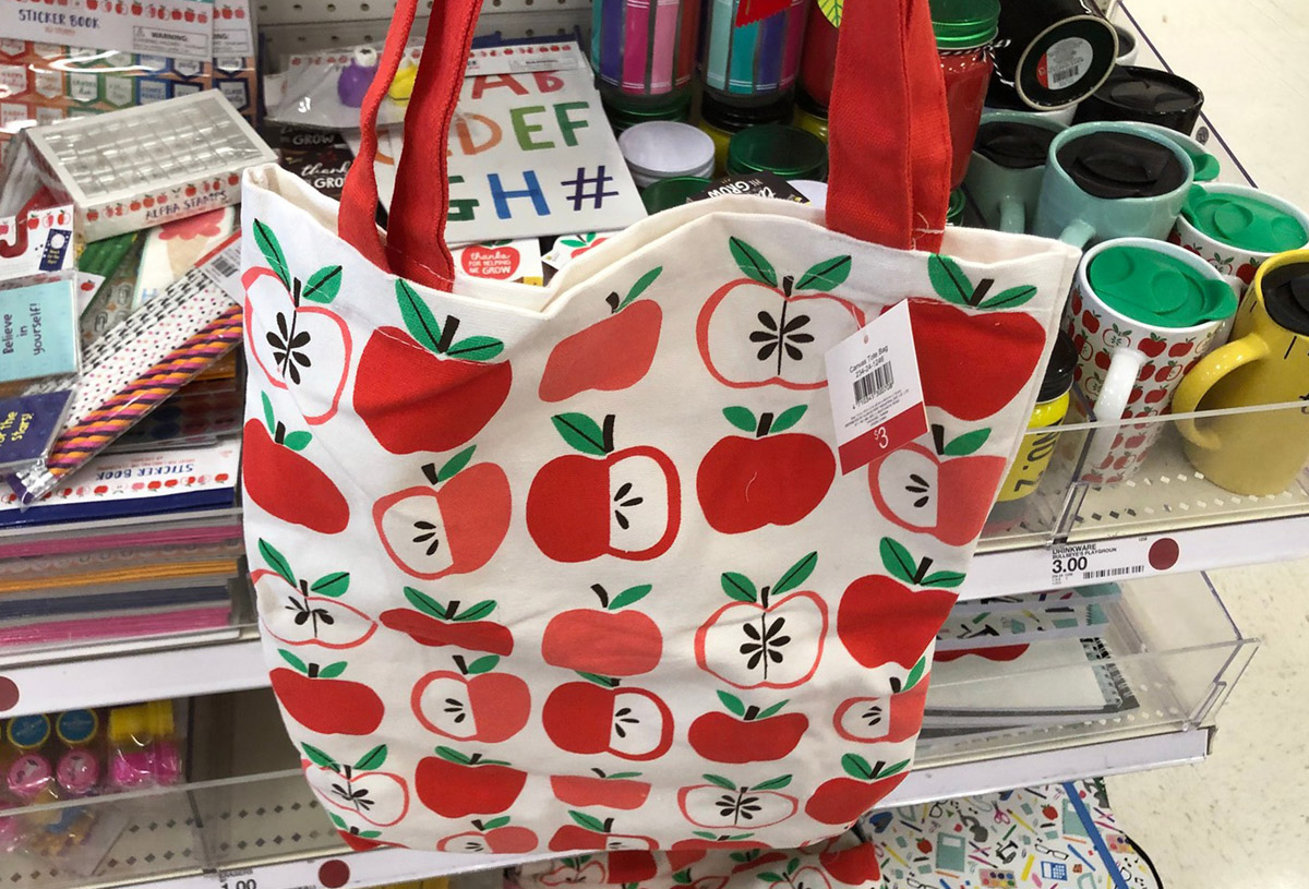 apple print tote bag in front of a store shelf