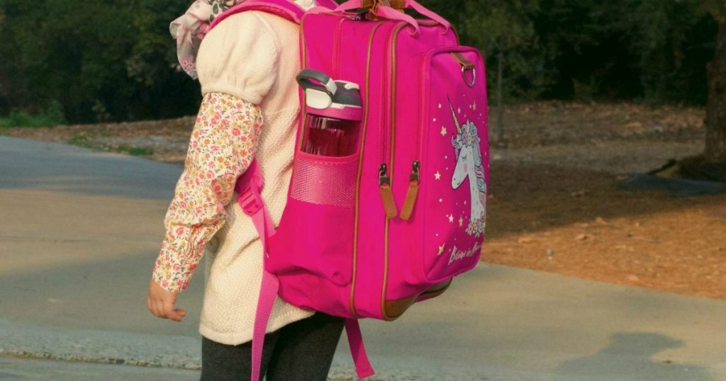 girl wearing pink unicorn backpack