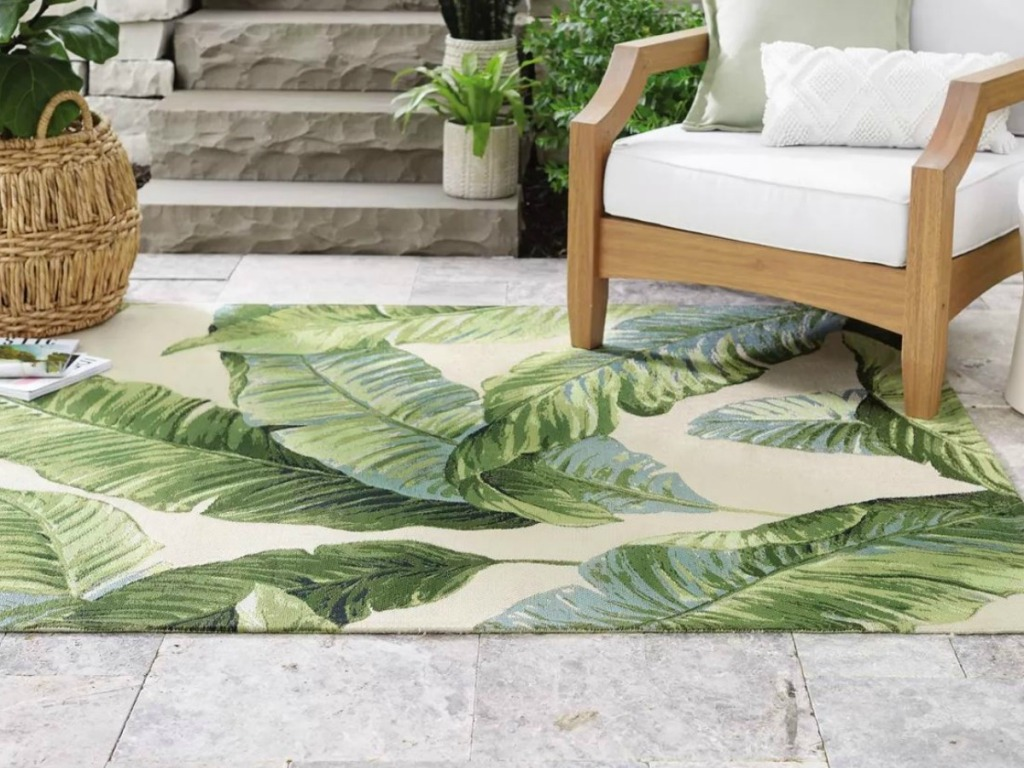 freen leaves rug outside with patio furniture