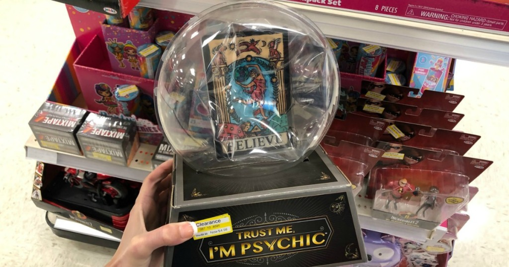 hand holding game that looks like crystal ball in store