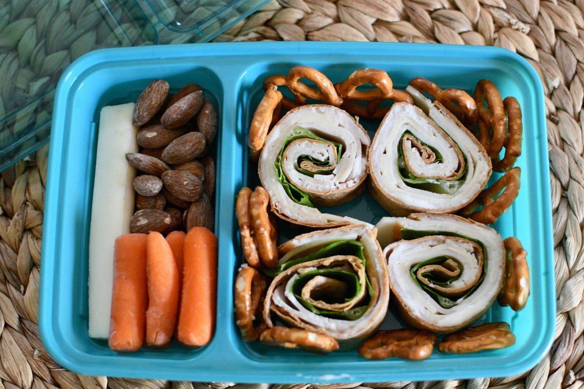 turkey and cheese roll-up wrap in a lunch container