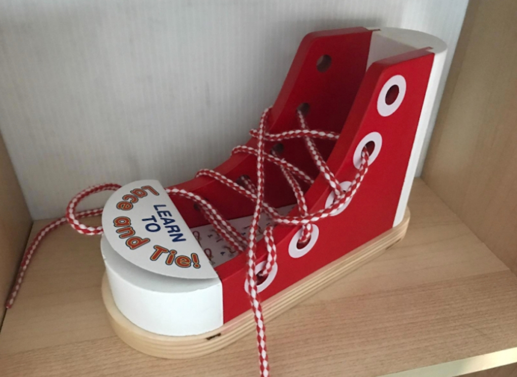 red and white wooden shoes with laces