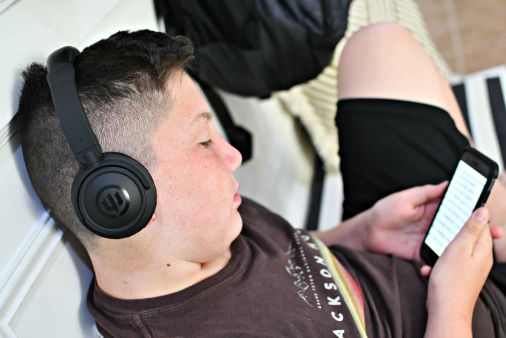 boy listening to audio books using headphones
